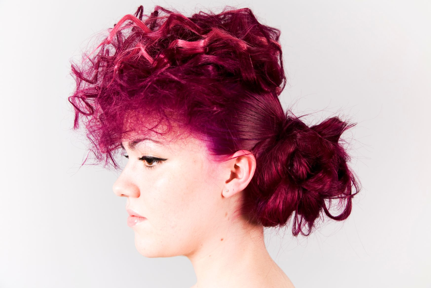 woman with red hair on upstyle