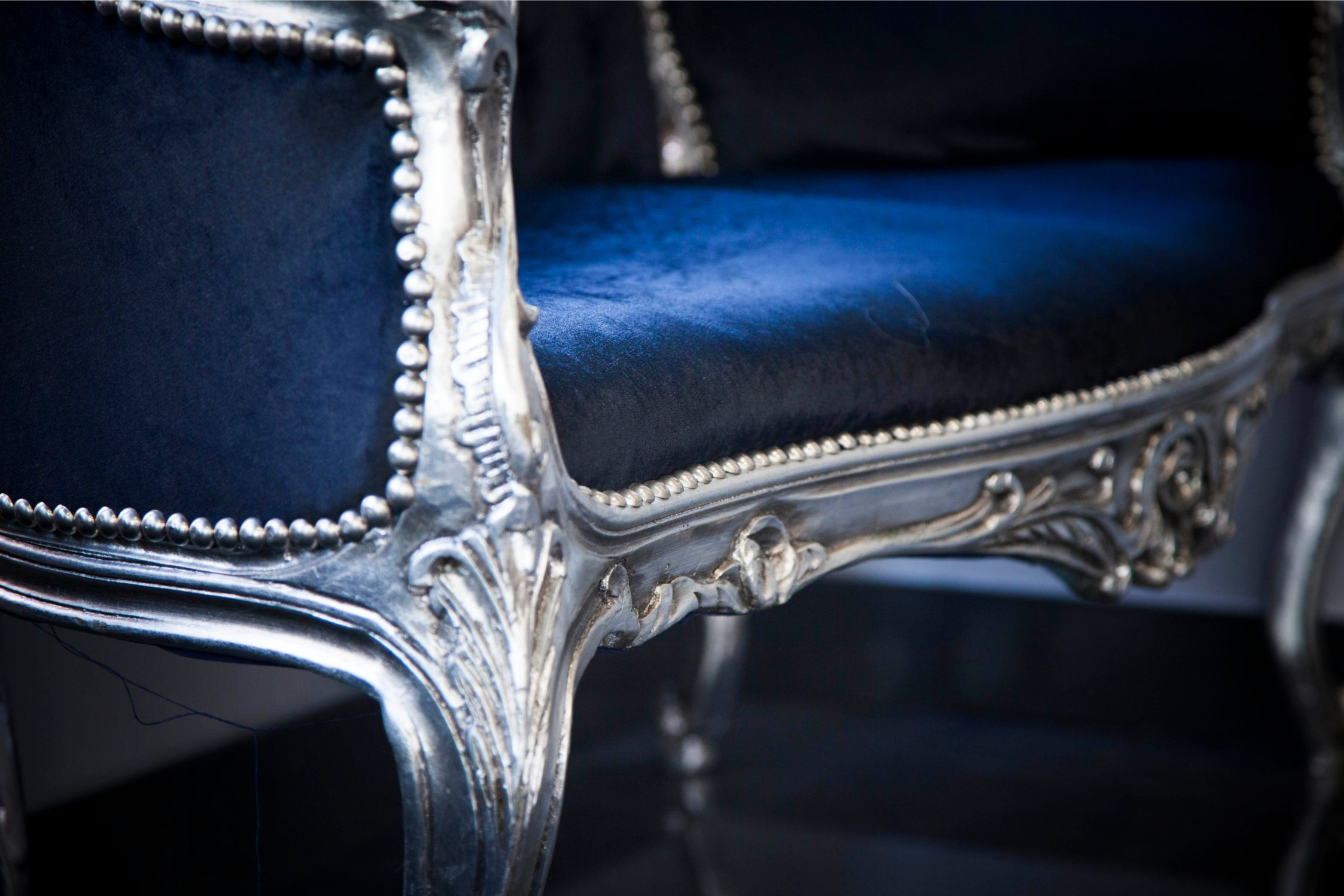 allure hair and beauty salon blue chair close up