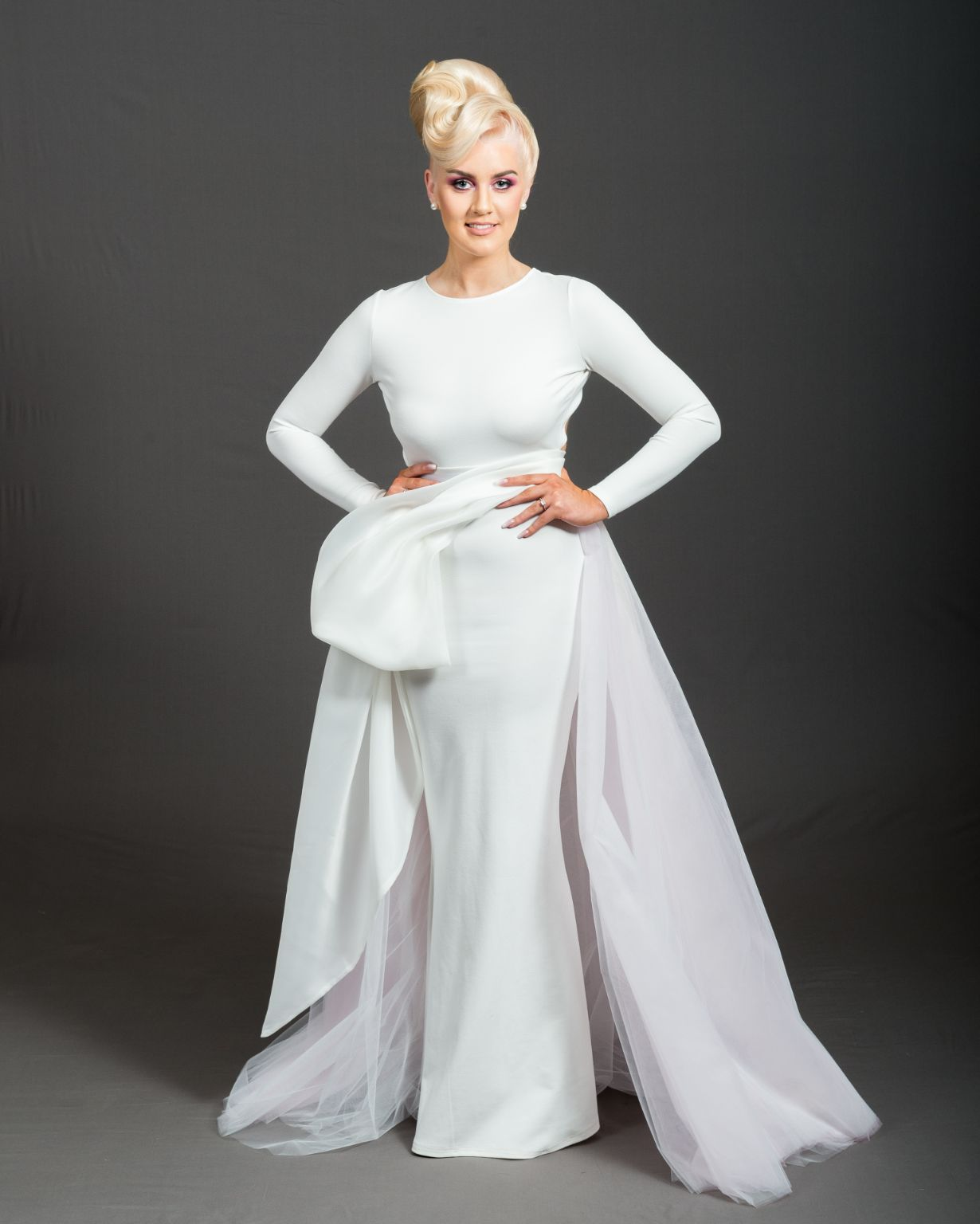 woman with blonde hair on upstyle wearing white dress